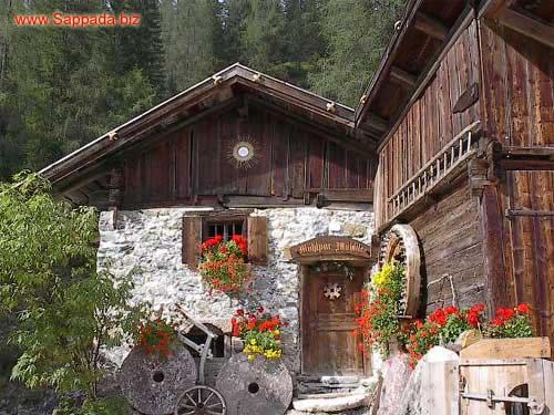 Foto di montagna sappada dolomiti for Disegni di case di tronchi